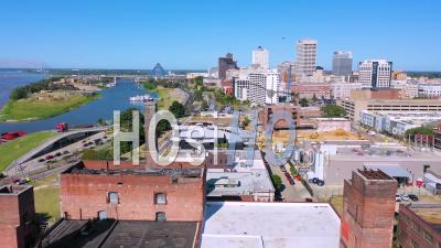 Memphis Tennessee Waterfront And Mud Island With Memphis Pyramid Background And Old Brick Factories Foreground - Aerial Video By Drone