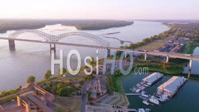 A Barge On The Mississippi River With Hernando De Soto Bridge Foreground - Aerial Video By Drone