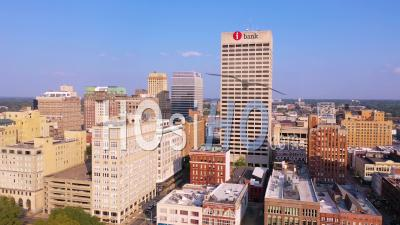 Downtown Memphis Tennessee, High Rises, Skyscrapers, Businesses, Skyline, Barge On Mississippi River - Aerial Video By Drone