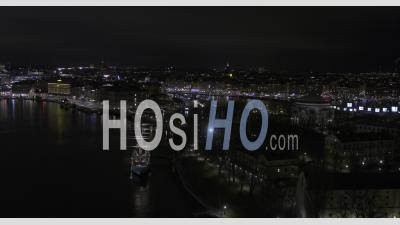 Aerial, Night City Scape Over Stockholm - Aerial Video By Drone