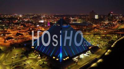 The Memphis Pyramid, Hernando De Soto Bridge And Downtown Memphis Cityscape At Dusk - Aerial Video By Drone