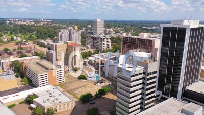 Buildings In The Downtown Business District Of Jackson, Mississippi With State Capitol Distant - Aerial Video By Drone