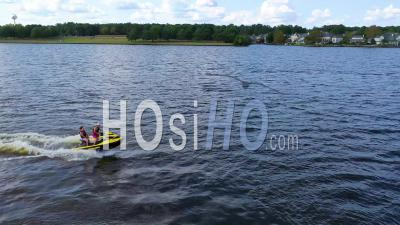 Jet Skiers Having Fun With Jet Ski On Ross R Barnett Reservoir Near Old Trace Park, Jackson, Mississippi - Aerial Video By Drone