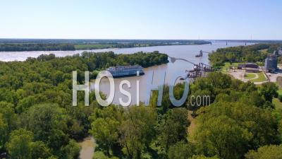 A Paddlewheel Steamboat Luxury Cruise Ship Docked In A Bay On The Mississippi River - Aerial Video By Drone