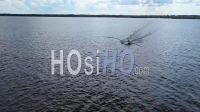 Aerial Video Of Jet Skiers Having Fun With Jet Ski On Ross R Barnett Reservoir Near Old Trace Park, Jackson, Mississippi - Drone Stock Footage