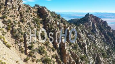 Aerial Over Stone Mountaintop Along A Ridge In The Eastern Sierra Mountains Near Lone Pine And The Owens Valley California. - Drone Point Of View