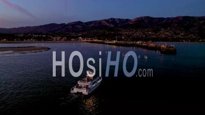 2020 - Night Dusk Or Twilight Aerial Over A Fishing Boat Entering Santa Barbara Harbor. - Drone Point Of View