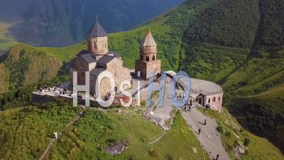 2019 - Aerial Video Around The Gergeti Monastery And Church Overlooking The Caucasus Mountains In The Republic Of Georgia - Video Drone Footage