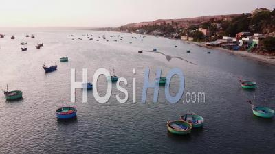 Vietnamese Fishing Boats Parked In Bay During Sunset - Aerial Video By Drone