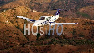 Beechcraft Duchess 76 Flying Over Mountains