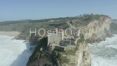 Nazare's Lighthouse From The Sea - Video Drone Footage