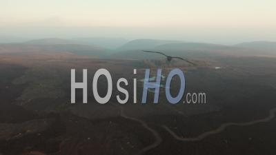 Pole Cottage Pools And Surrounding Fields And Hills At Hazy Sunset - Video Drone Footage