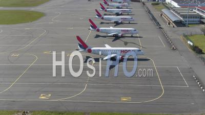 Lille Lesquin Airport Hosting A Complete Fleet Of Hop Airliners In Front Of A Close Terminal - Video Drone Footage