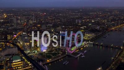 London Eye, Southbank, River Thames And Westminster At Night, London Filmed By Helicopter