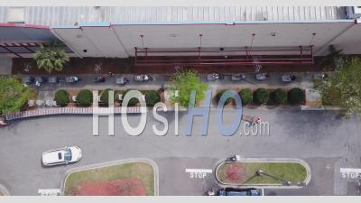 Big Line With People With Empty Carts Going Shopping - Video Drone Footage