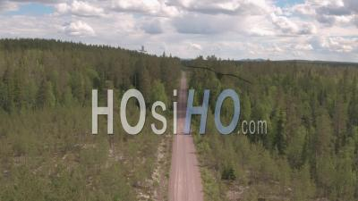 Aerial View Along A Track In The Middle Of A Fir Trees Forest, Tackasen, Sweden - Video Drone Footage