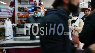 Covid 19- Cashier With Mask In Grocery
