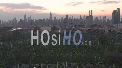 Aerial Of Vast Cemetery In New York City Suggests Victims From Coronavirus Covid-19 Pandemic Epidemic Outbreak Deaths. - Video Drone Footage