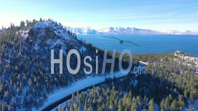 2020- Beautiful Aerial Of Highway 50 Approaching Lake Tahoe In Snow And Winter With Traffic On Highway Below. - Video Drone Footage