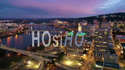 High Angle Pan Of Downtown Business District Portland Oregon At Night. - Video Drone Footage