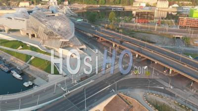 Traffic In Confluence District With Musuem And Highway Roads, City Of Lyon, During Covid 19 Lockdown - Video Drone Footage