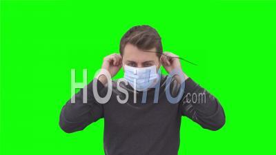 Man Putting On Face Mask