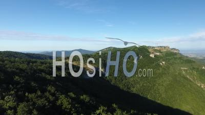 Green Mountains And Cliffs Under A Blue Sky In South Of France - Video Drone Footage