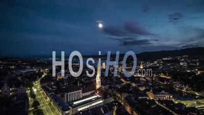 Aerial View Shot Of Zurich, Beautiful Old Town At Night Evening, Switzerland - Video Drone Footage
