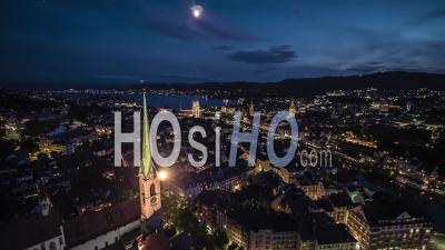 Aerial View Shot Of Zurich At Night Evening, Old Town, Switzerland - Video Drone Footage