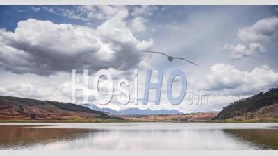 Timelapse Of Peru Landscape At A Lake Near Cusco In The Andes Mountains Range. Time Lapse Of Clouds Moving In Typical Peruvian Scenery In South America