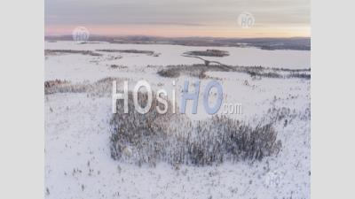 Romantic Heart Shaped Forest In A Snow Covered Winter Landscape In The Arctic Circle, Lapland, Finland Drone