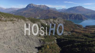 Aerial View Of The Lac De Serre-Poncon Lake, Forest And Mountains, French Alps, France – By Drone