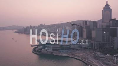 Hong Kong Harbour And Downtown City Centre Sunrise. Aerial Drone View At Sunrise