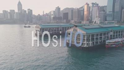 Hong Kong Star Ferry Central Terminal And Harbour Front. Aerial Drone View