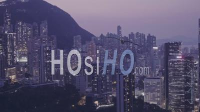 Hong Kong Downtown Skyscrapers And Buildings Cityscape At Night. Aerial Drone View