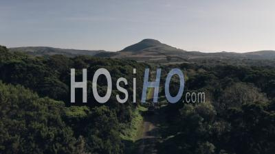 4 Wheel Drive Vehicle Driving Through Forest Scenery In Aberdare National Park, Kenya, Africa. Aerial Drone View Of Safari