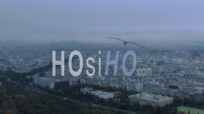 Aerial Footage Of Paris, Outlying Street And Monuments Under A Cloudy Sky, Seen From Helicopter
