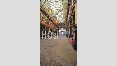 Leadenhall Market Vertical Video In The City Of London, A Popular Tourist Area During Coronavirus Covid-19 Lockdown With Empty Streets, No People And Shops Shut In England, Europe