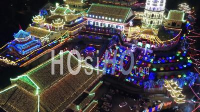 Drone Shot With Slowly Rise Up To Reveal Kek Lok Si Temple In Night.
