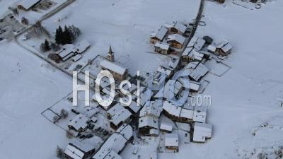 Aerial Footage Of A Mountain Village Under Snow In The Vanoise National Park, Seen From Drone, Champagny-Le-Haut, Savoie, France