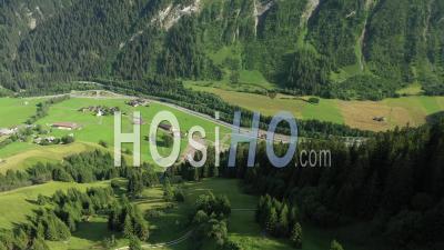 Medels Im Rheinwald, Green Forest, Winding Road In Swiss Alps Winding Road - Video Drone Footage