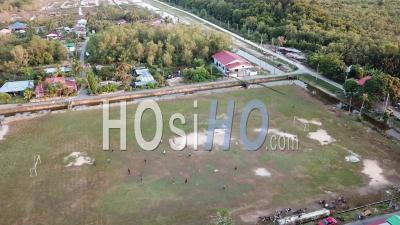 Aerial View Local Malays Play Football At Green Field - Video Drone Footage