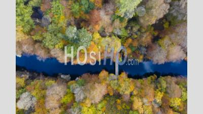 Autumnal Colours In Trees Beside The River Garry Seen From A Drone At Killiecrankie In Perthshire, Scotland, Uk
