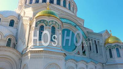Kronstadt Naval Cathedral View Of Golden Domes, Mosaics And Stained Glass Windows Close Up Shot, Backlight - Video Drone Footage