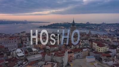 Galata Tower In Center Of Istanbul Night To Day With Bosphorus And Istanbul Skyline, Aerial Hyperlapse Drone Time Lapse Forward