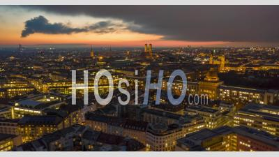 Stunning Munich Cityscape At Night With Glowing City Streets And Office Building, Magical Day To Night Aerial Hyper Lapse Moving Time Lapse Above Big Metropolitan Area - Video Drone Footage