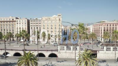 Barcelona Residential Apartment Buildings By The Water With Palm Trees And Wind Blowing On Beautiful Sunny Day 4k - Video Drone Footage
