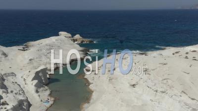 Wide Aerial Establishing Shot Of Sarakiniko Lunar Volcanic Beach In Milos Island, Greece 4k - Video Drone Footage
