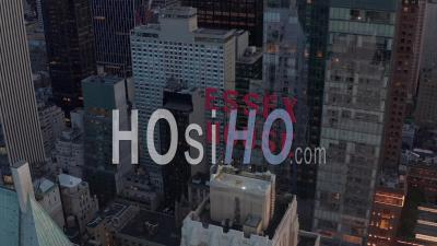 Close Up Of Essex House Manhattan Skyline At Wonderful Sunset With Flashing City Lights In New York City In Beautiful 4k - Video Drone Footage