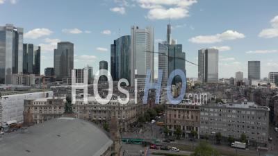 Aerial View Forward Flight Over Frankfurt Am Main, Germany Central Train Station With Skyline View And Public Transport On Street With People - Video Drone Footage